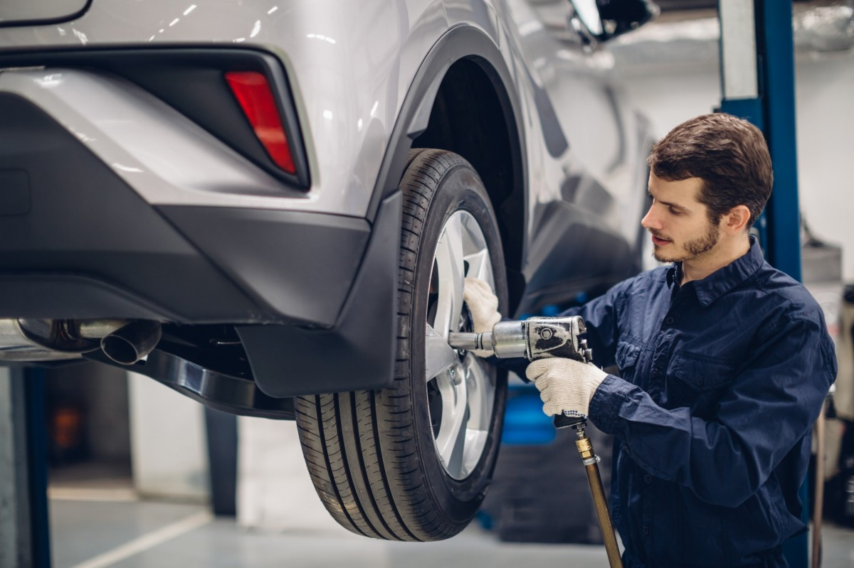 mechanic working on car tire